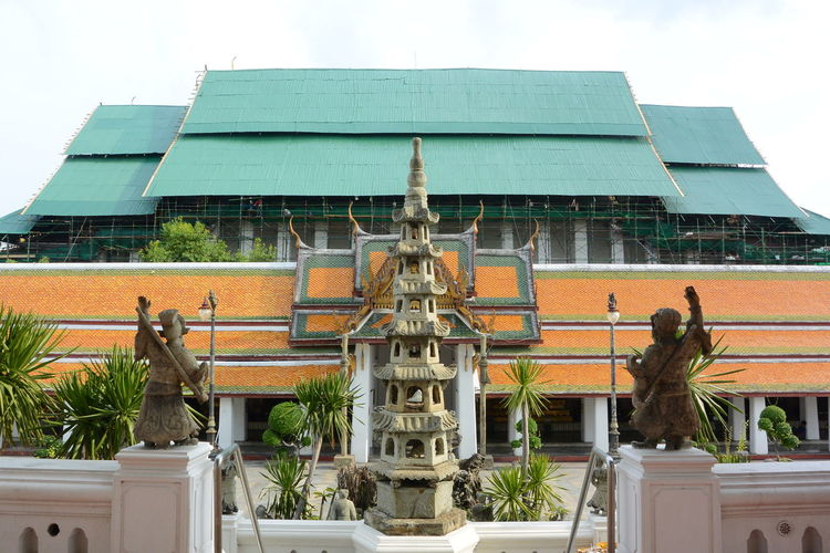 Animal Representation Architecture Art Art And Craft Buddha Buddhist Temple Building Building Exterior Built Structure Butterfly Church City Craft Creativity Day Female Likeness Low Angle View Sculpture Sky Statue Te Temple Wat Suthat