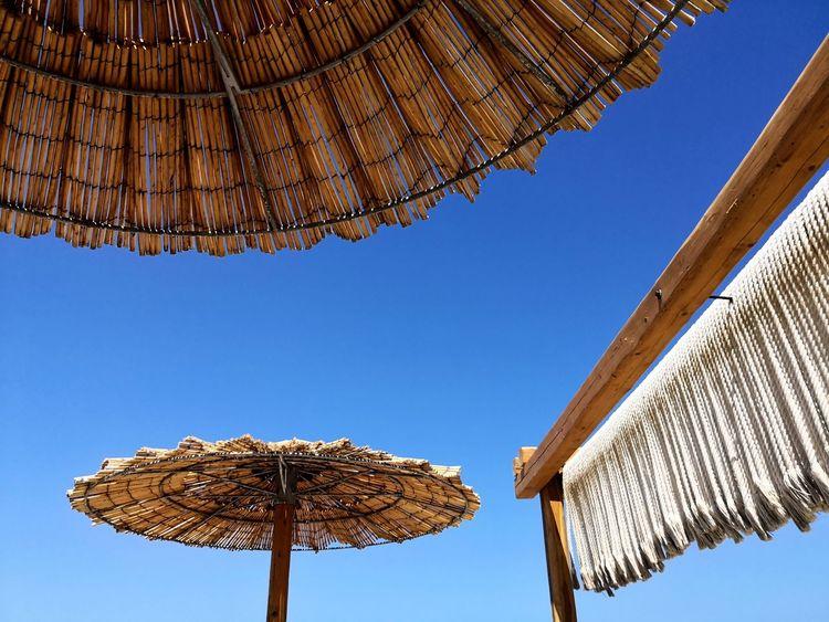 Sun protection Sunnyday☀️ Blue Sky Sonnenschirm Urlaub Ferien Erholung Pur Relaxing Holidays In Greece ❤ Enjoying Life Taking Photos EyeEm Selects Clear Sky Roof Blue Hanging Sky Beach Umbrella Sunshade