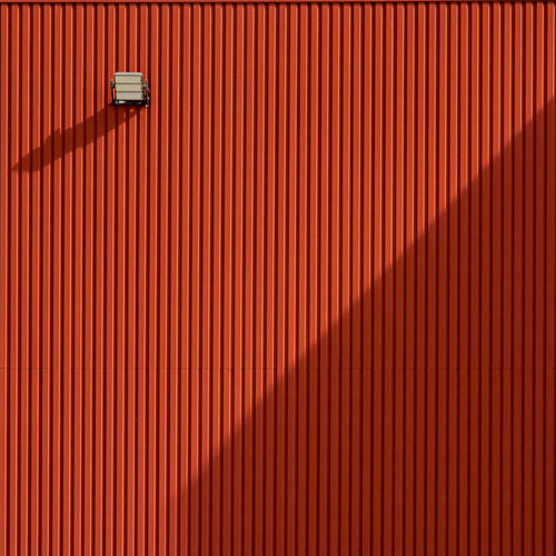 Illuminated red metal wall