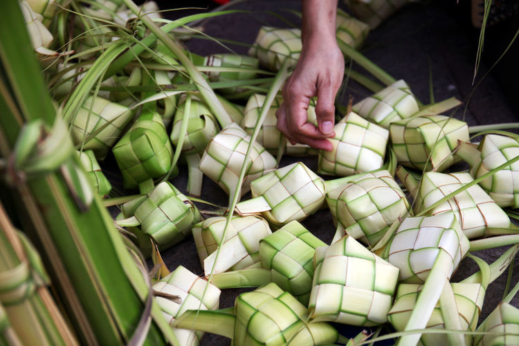 Ketupat for Eid Mubarak Celebration Abundance Close-up Day Eid Al Fitr Eid Mubarak Food Food And Drink Freshness Green Color Healthy Eating High Angle View Holding Human Body Part Human Hand Ketupat Large Group Of Objects Lifestyles One Person Outdoors People Real People