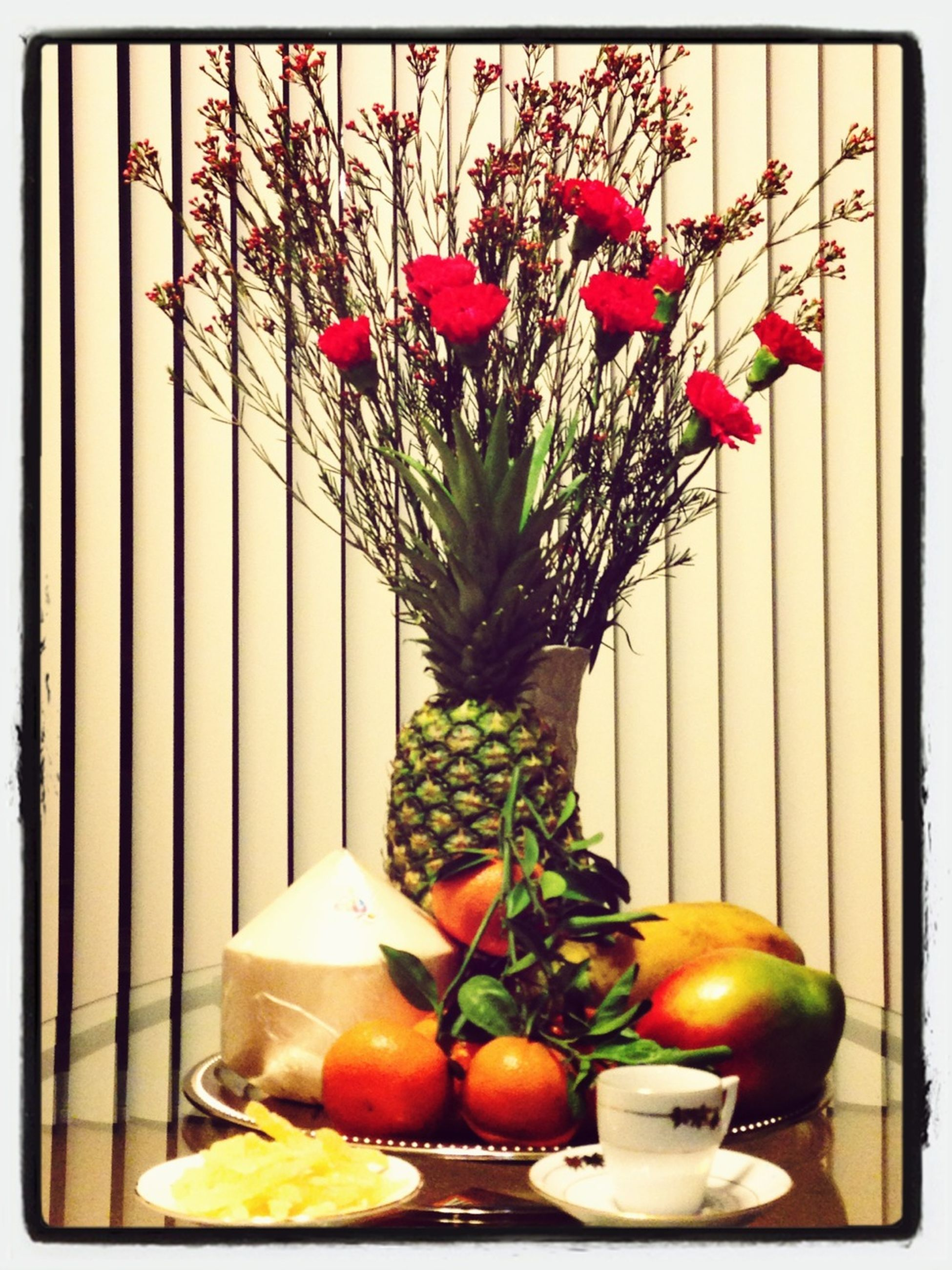 flower, freshness, vase, indoors, growth, potted plant, plant, red, transfer print, flower pot, fragility, leaf, home interior, stem, auto post production filter, table, decoration, fruit, nature, wall - building feature