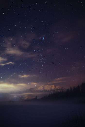 Fog over the frozen lake&a clearing sky. Night Lights Nightphotography Winter Wood Astronomy Beauty In Nature Clouds Constellation Fog Galaxy Lake Milky Way Mountain Nature Night Night Sky No People Outdoors Scenics Sky Space Star - Space Starry Tranquil Scene Tranquility
