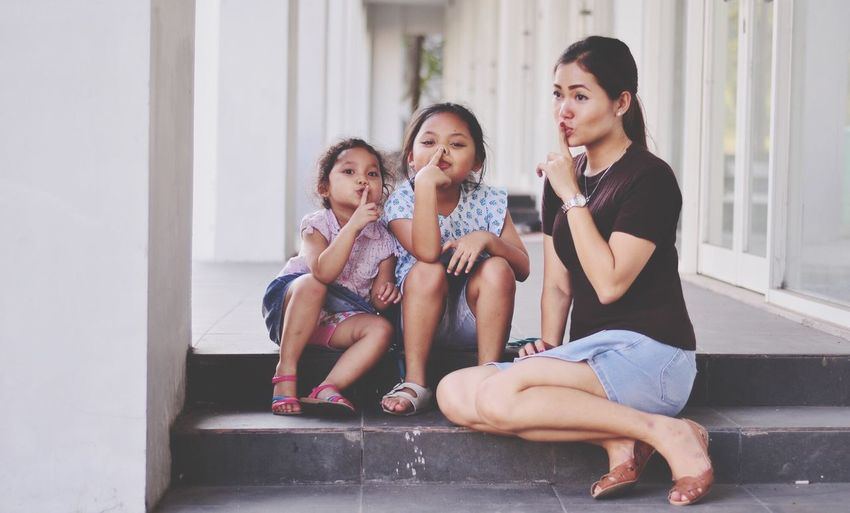 psssttt .... Sitting Childhood Mother Togetherness Happiness Real People Daughter Lifestyles Steps Leisure Activity