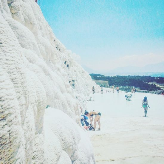 Mountain Sea Beauty In Nature Real People Vacations Outdoors Sky Water Clear Sky People Day Nature Travel Destinations Sunlight Pamukkale Cotton Castles White Stone