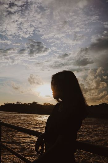 Sunset and my girlfriend. One Person Silhouette Side View Water Cloud - Sky Sky Real People Sunset Nature Standing Sea Beauty In Nature Women Leisure Activity