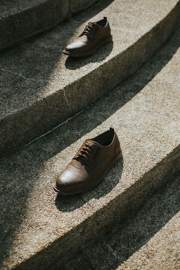 High angle view of shoes on footpath