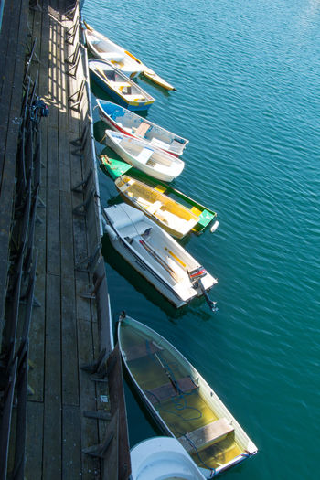Docked Dingys Beauty In Nature Day High Angle View Mode Of Transportation Moored Nature Nautical Vessel No People Outdoors Rowboat Sailboat Scenics - Nature Sea Sunlight Tranquil Scene Tranquility Transportation Travel Water Wood - Material