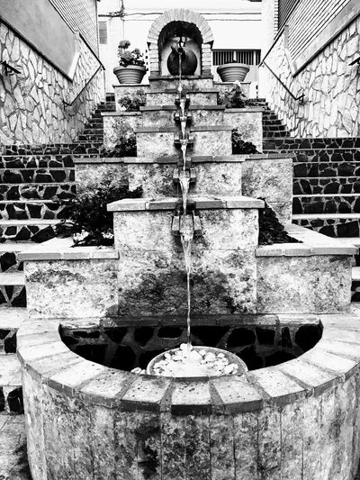 Architecture Belief Building Exterior Built Structure Day Drinking Fountain Flowing Fountain Household Equipment Kitchen Utensil Metal Motion Nature No People Outdoors Place Of Worship Religion Running Water Wall Wall - Building Feature Water Well