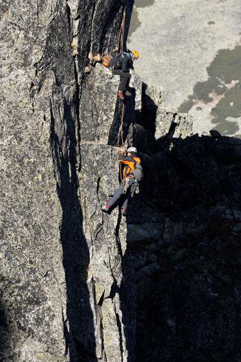 People climbing on rock