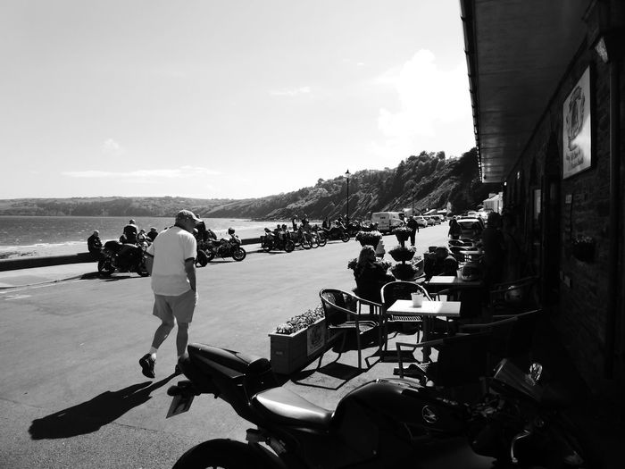 Sea Sky Sunlight Day Transportation Real People Mode Of Transport Men Shadow Beach Outdoors Water Laxey Motorcycle Julian Melling Tt Architecture Nautical Vessel Building Exterior Togetherness Full Length Nature Adult