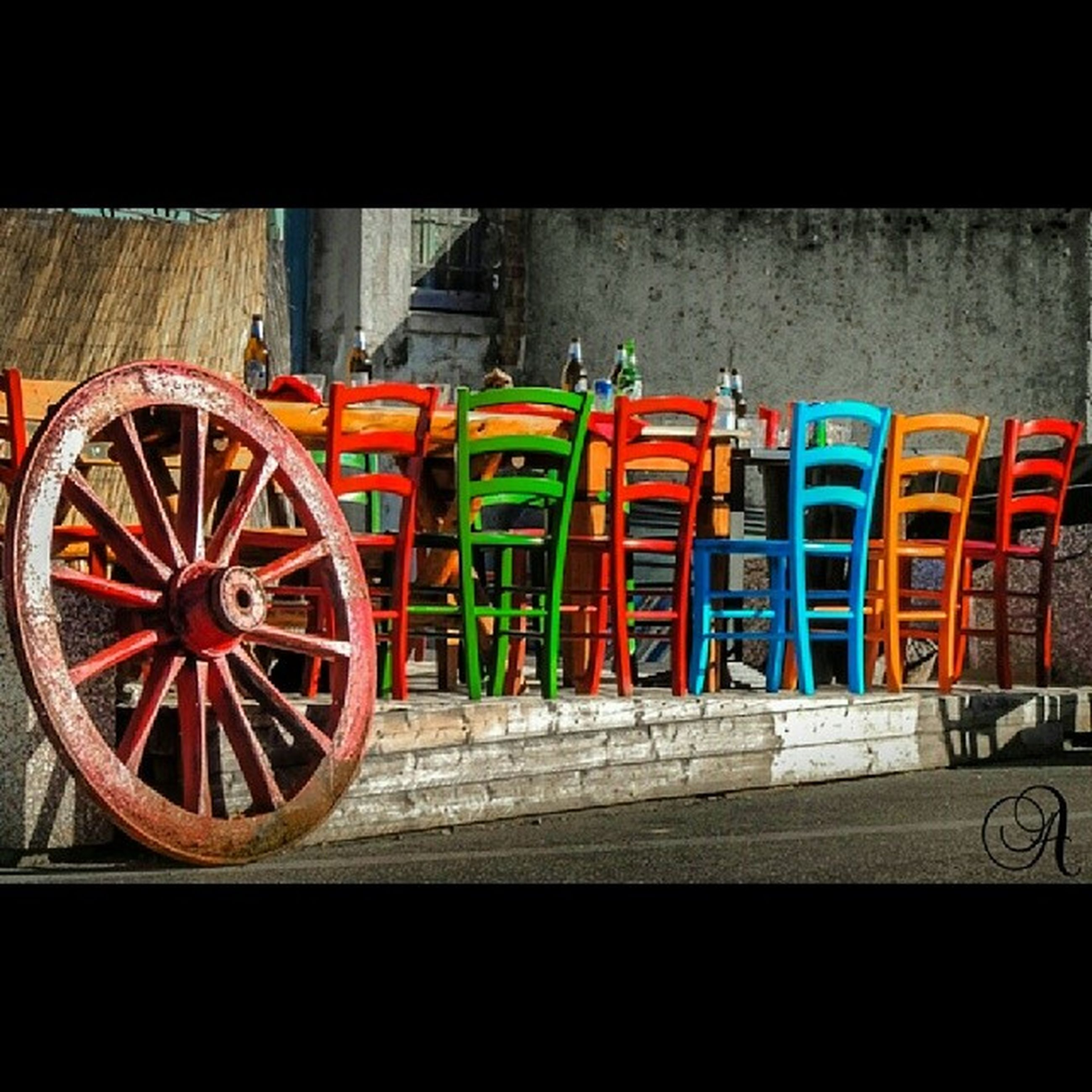 transportation, bicycle, mode of transport, wheel, stationary, land vehicle, wall - building feature, red, no people, built structure, outdoors, parking, day, parked, architecture, auto post production filter, graffiti, multi colored, railing, metal