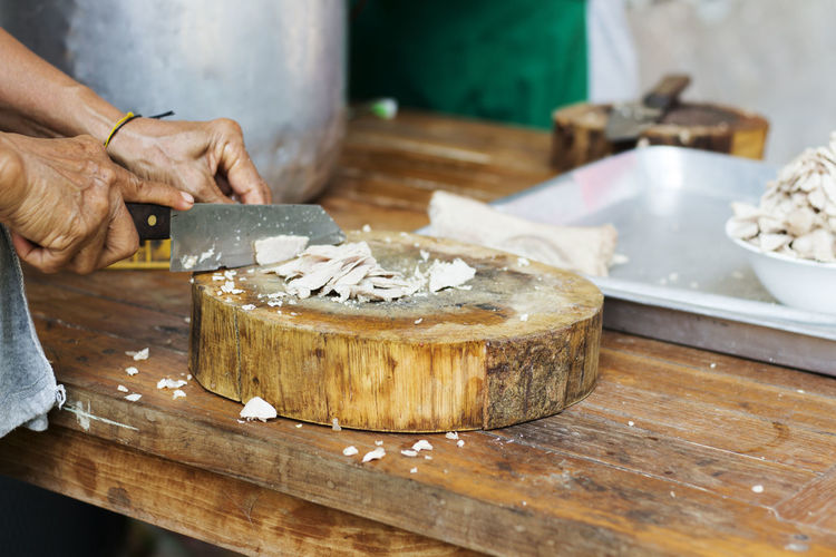 Adult Adults Only Butcher Close-up Day Freshness Human Body Part Human Hand Indoors  Kitchen Kitchen Knife Men Occupation One Person People Preparation  Skill  Table Wood - Material Workshop