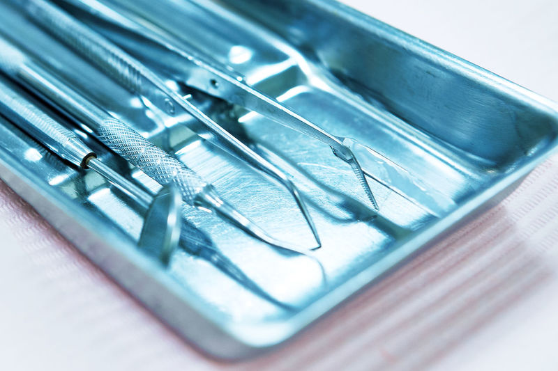 Close-up of dental equipment in tray on table