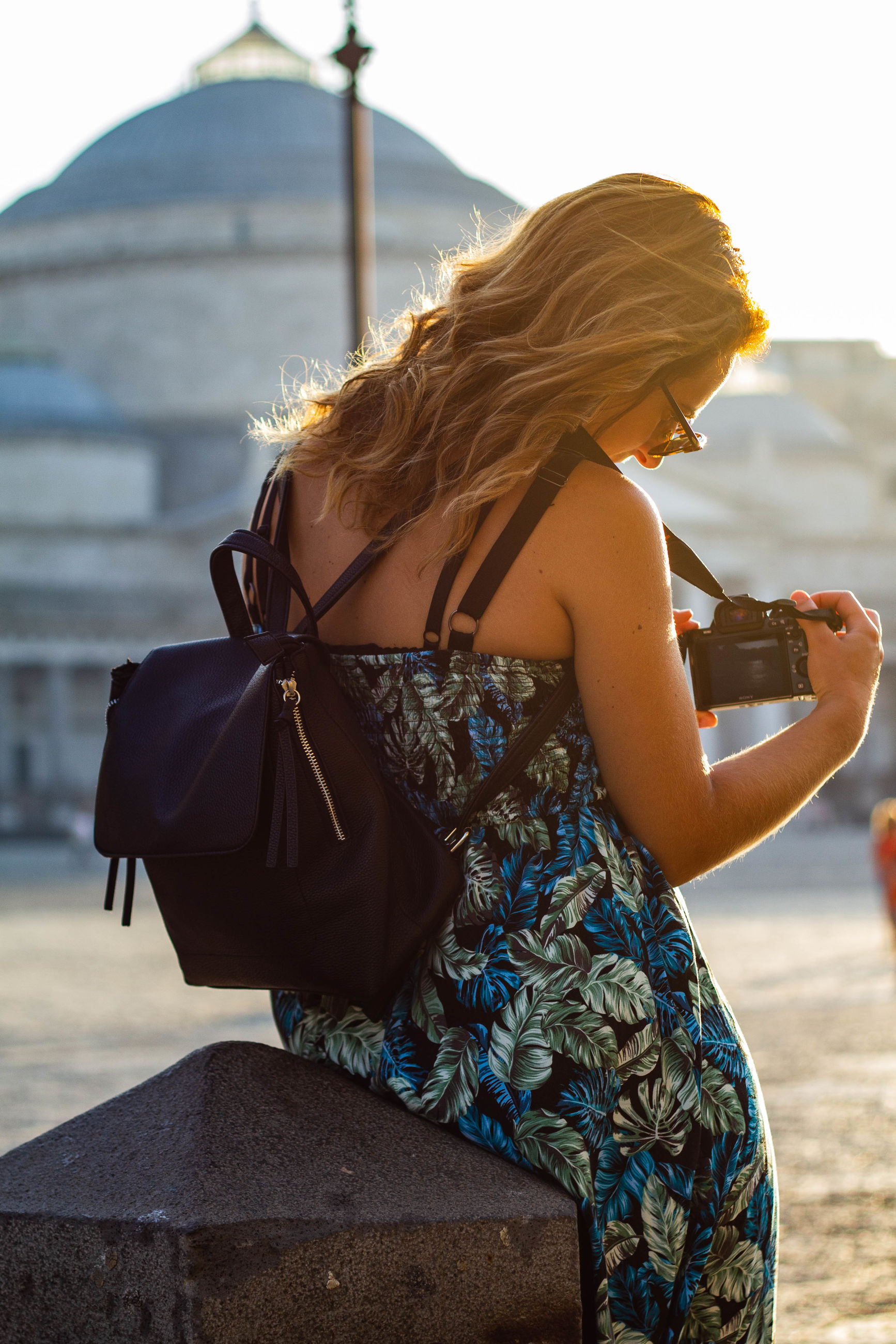 one person, lifestyles, real people, women, leisure activity, water, focus on foreground, sky, adult, fashion, clothing, rear view, nature, standing, dress, outdoors, three quarter length, day, young adult, hairstyle, hair, beautiful woman, floral pattern