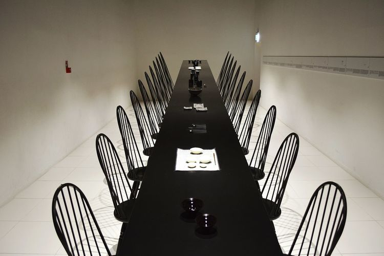 High Angle View Of Empty Chairs At Dining Room