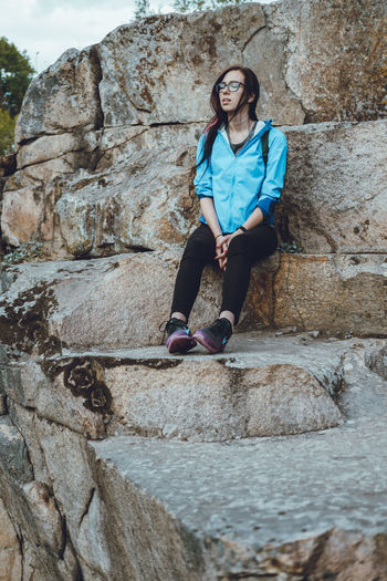 Rock Formation Adult Adventure Beautiful Woman Casual Clothing Childhood Day Front View Full Length Girls Happiness Leisure Activity Lifestyles Looking At Camera One Person Outdoors People Portrait Real People Rock - Object Rocks Smiling Steps Young Adult Young Women