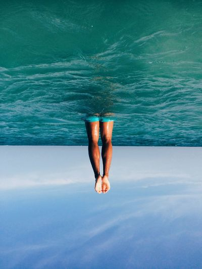 Falling out of the ocean Water One Person Lifestyles Nature Real People Day Human Body Part Human Leg Body Part Casual Clothing Sea Leisure Activity Relaxation