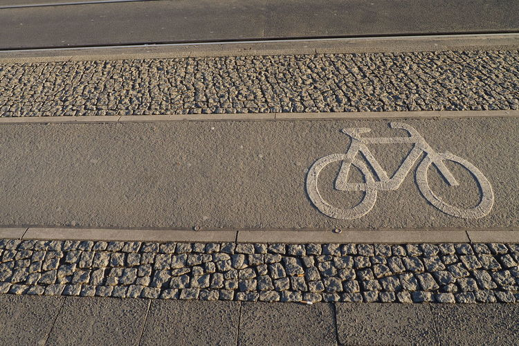 Asphalt Asphalte Bike Bike Lane Biking Communication Cycling Low Section Riding Riding Bike Road Sidewalk Sign Street Transportation