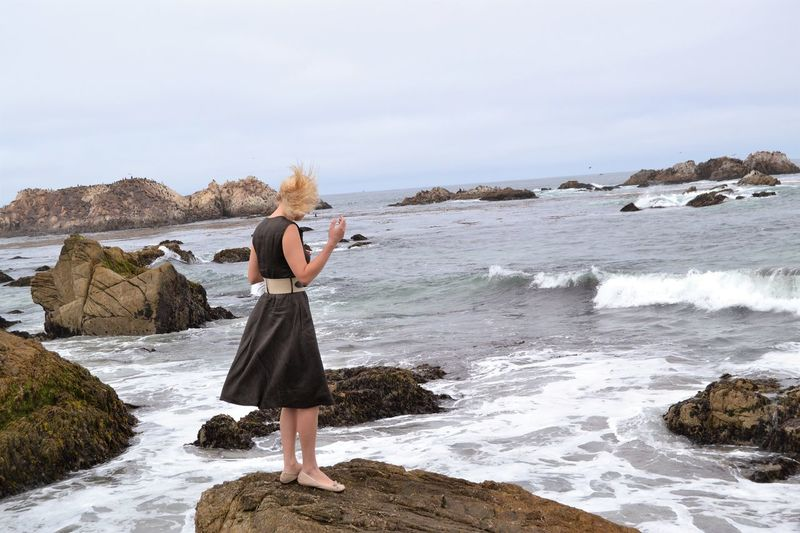 Girl standing on rocks, , 17 mile drive near San Francisco, wind, water, fresh air. 17 Mile Drive Beach Beautiful Woman Beauty In Nature Blond Hair Day Dress Full Length Holding Horizon Over Water Leisure Activity Nature One Person Outdoors Photographing Photography Themes Real People Rock - Object Scenics Sea Sky Standing Water Wave Young Adult