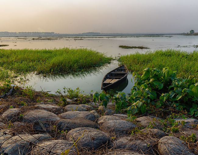 the boat EyeEmNewHere Siliguri WestBengal Beauty In Nature Boat Day Grass Green Color Growth Idyllic Jalpaiguri Lake Land Nature Nautical Vessel No People Non-urban Scene Plant Reflection Scenics - Nature Sky Teesta River Tranquil Scene Tranquility Water