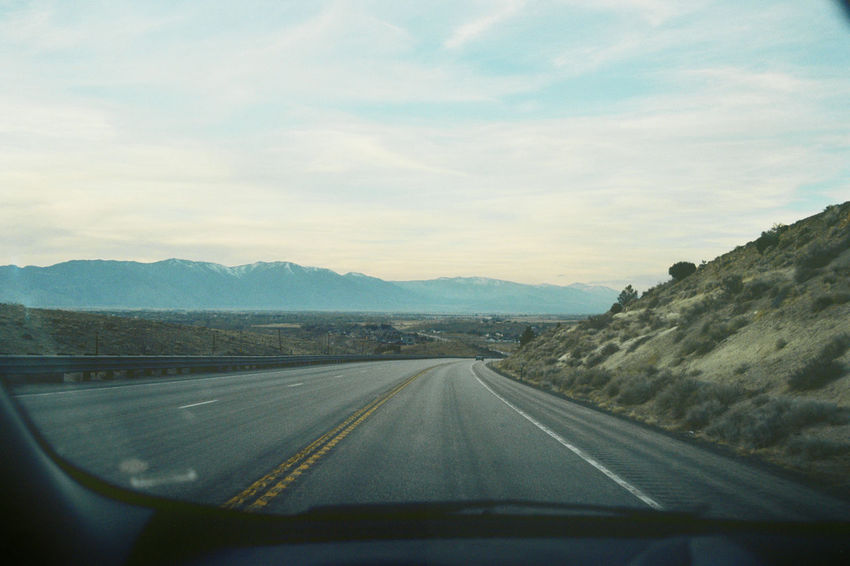 Country Road Diminishing Perspective Film Photography Filmisnotdead Highway Landscape Liveauthentic Livefolk Mountain Mountain Range Nevada On The Road Outdoors Road Roadtrip Scenics Sky The Way Forward Tranquil Scene Tranquility USA Vanishing Point Windshield