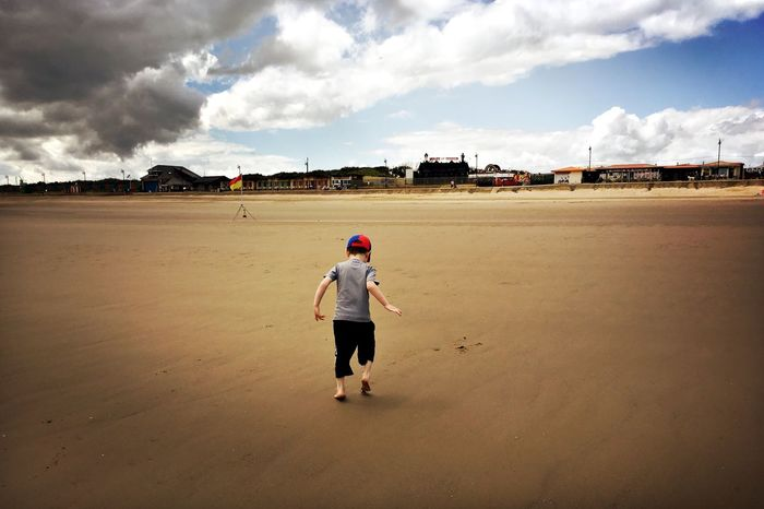 On the beach Mablethorpe Seaside Beach Life Beach EyeEm Selects Cloud - Sky Sky One Person Real People Childhood Outdoors Day Sand Landscape People Beach Full Length