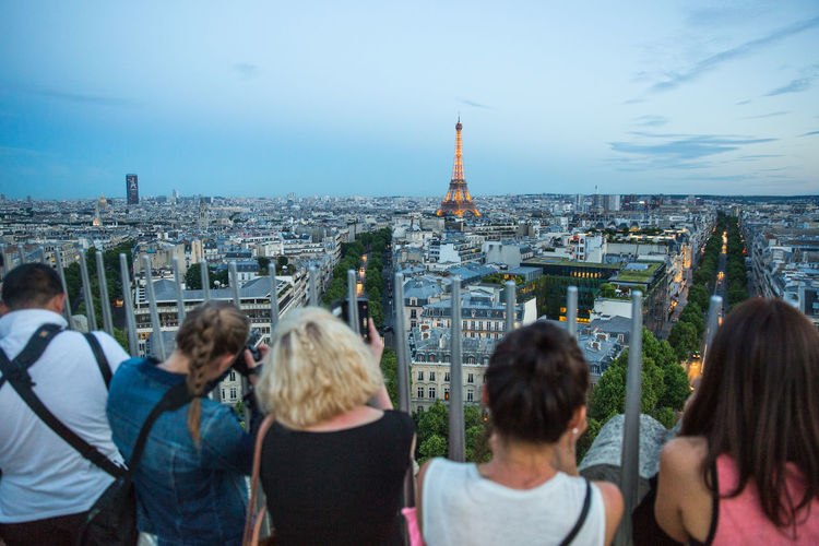 Arc De Triomphe City Cityscape Crowded Dusk Dusk In The City Eiffel Tower France Large Group Of People Lifestyles Lookout Observation Point Paris Paris Je T Aime Paris, France  ParisByNight Real People Sunset Tour Eiffel Tourism Tourists Travel Destinations Urban Skyline View