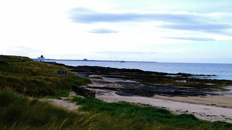 looking towards Lindisfarne from Bamburgh Lindisfarne Trinity House Bamburgh Northumberland Seascape