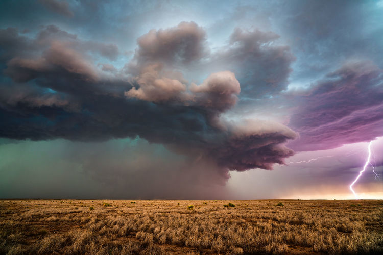 Lightning strikes from a supercell thunderstorm near roswell, new mexico.