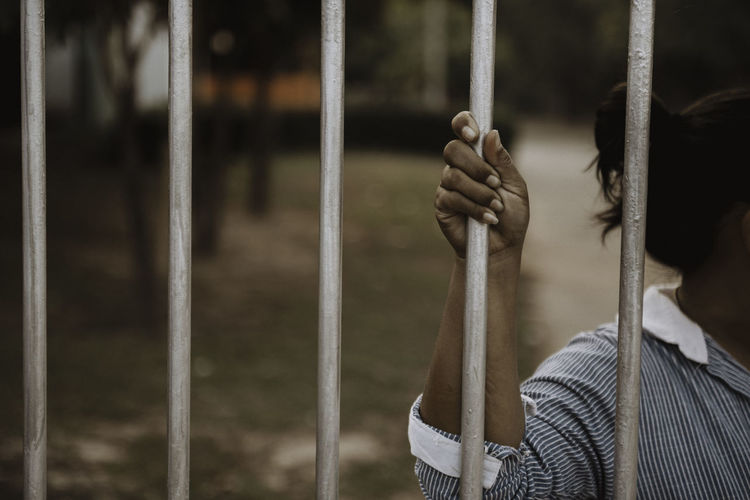 Hands of women desperate to catch the iron prison,prisoner concept,hope to be free.
