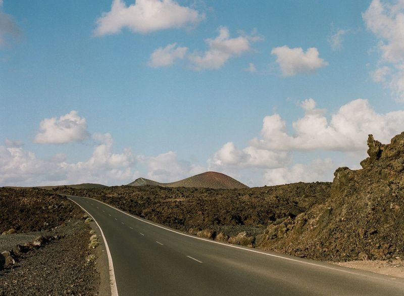 Road in lava field Mountain Desert Dry Roadtonowhere Lava Volcano Volcanoes Road Sky Cloud - Sky Transportation The Way Forward Landscape Scenics Nature Tranquility Day Tranquil Scene Beauty In Nature Mountain No People Outdoors