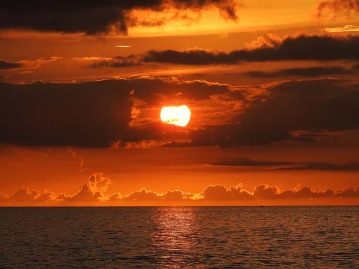 Sunset Sunset Water Sky Beauty In Nature Sea Scenics - Nature Cloud - Sky Tranquility Tranquil Scene Orange Color Sun Idyllic Nature Waterfront Reflection Sunlight Outdoors No People Horizon Over Water Horizon