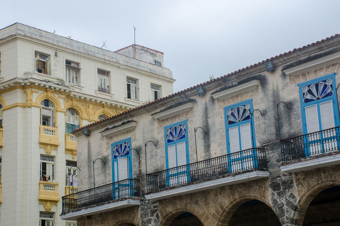 Yellow and Blue painted windows in Havana Cuba Havana Spanish Spanish Style UNESCO World Heritage Site Blue Building Old Old Buildings Traditional Unesco Yellow