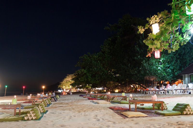 Panoramic view of beach against sky at night