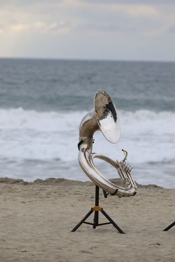 Beach Blowing Instrument Day Music Musical Instrument No People Ocean Outdoors Sand Sea Tuba