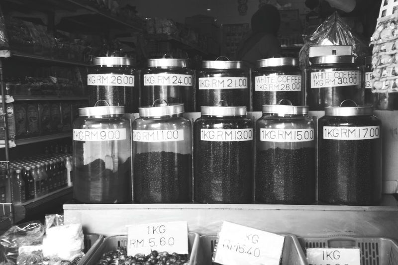10 different qualities of coffee bean jars in black and white photograph, symbolising the black and white coffee which are the two most common type of coffees served in my world offers a variety kind of coffees, not just the two types found in my photography, camera nowadays offers a lot of types of pictures that you want - not just the black and white picture like the old days! Openness Lumix Blackandwhitephotography Coffeebeanjar Coffeebeans Oldshophouse Kuching Old Shop 10 For Sale Shop Retail Display Price Tag Variety The Street Photographer - 2018 EyeEm Awards