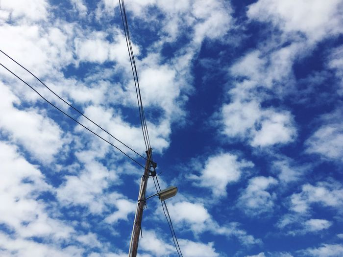 Cable Low Angle View Connection Sky Cloud - Sky Technology Day Power Line  Power Supply Fuel And Power Generation Blue Outdoors No People Electricity  Telephone Line Nature
