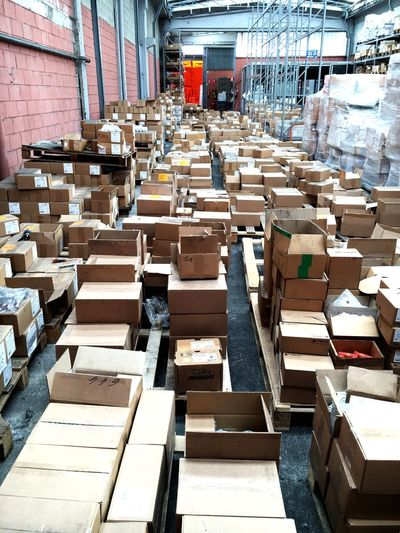 High angle view of cardboard boxes on pallets in factory