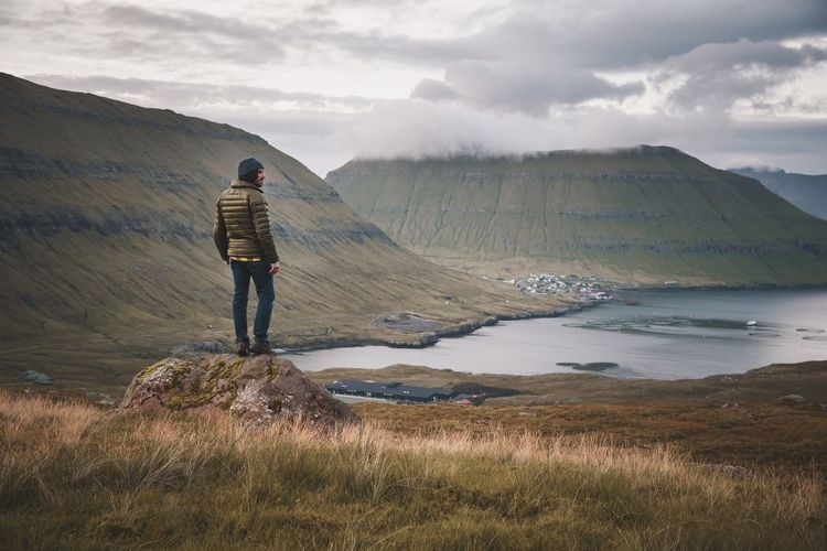 Fjord Precipice Faroe Islands Solitude Cloud - Sky One Person Beauty In Nature Full Length Rear View Nature Landscape Scenics Mountain Real People Leisure Activity Sky Standing Tranquil Scene Outdoors Tranquility Lifestyles Day Vacations Hiking