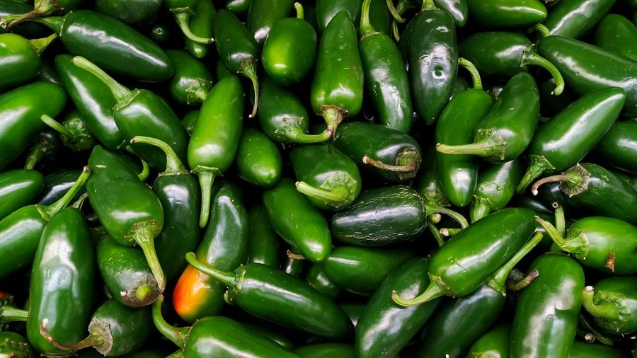Full frame shot of green chili peppers at market stall