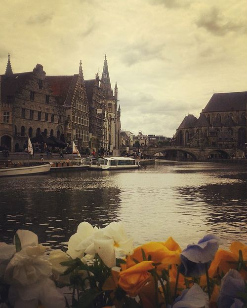 Souvenir from Gent. Reflection Outdoors Water Nature Sky Gent Gand Belgium Belgique Canals And Waterways Canals Cloudy Flowers Flemish Architecture Flemish Vlaams Flanders Boats Flemish Brabant Boat Trip Bridges Ghent Belgio Travel Destinations Cityscape