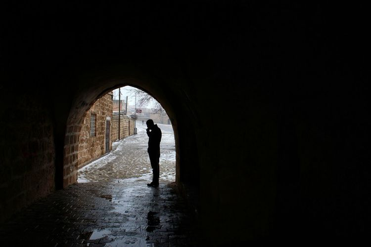 Mardin Travel History Cinematography Lensculture Waiting People Streetphotography Turkey Snow Full Length Silhouette Tunnel Arch Dark Architecture Chiaroscuro  Light At The End Of The Tunnel Hiker Underground Walkway Underground Stalactite  RainDrop Monsoon My Best Photo