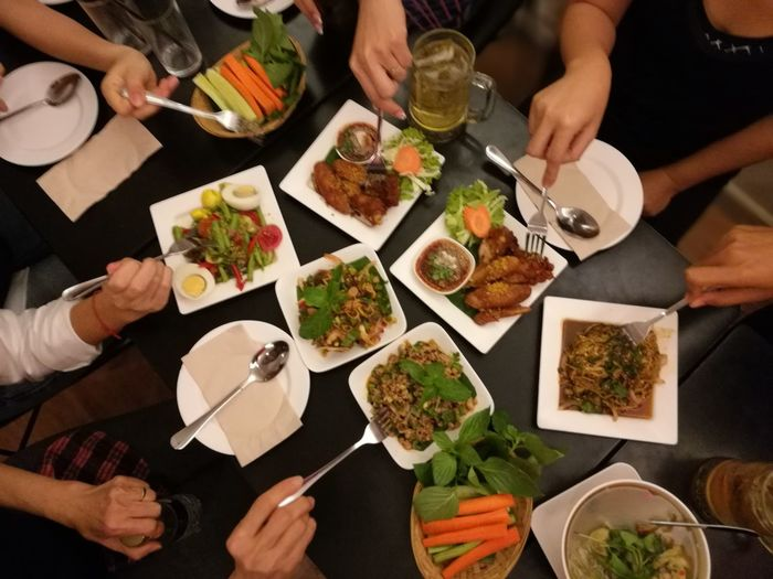 Table Food And Drink Togetherness High Angle View Eating Human Body Part People Plate Friendship Food Meal Ready-to-eat Indoors  Healthy Eating Women Adults Only Human Hand
