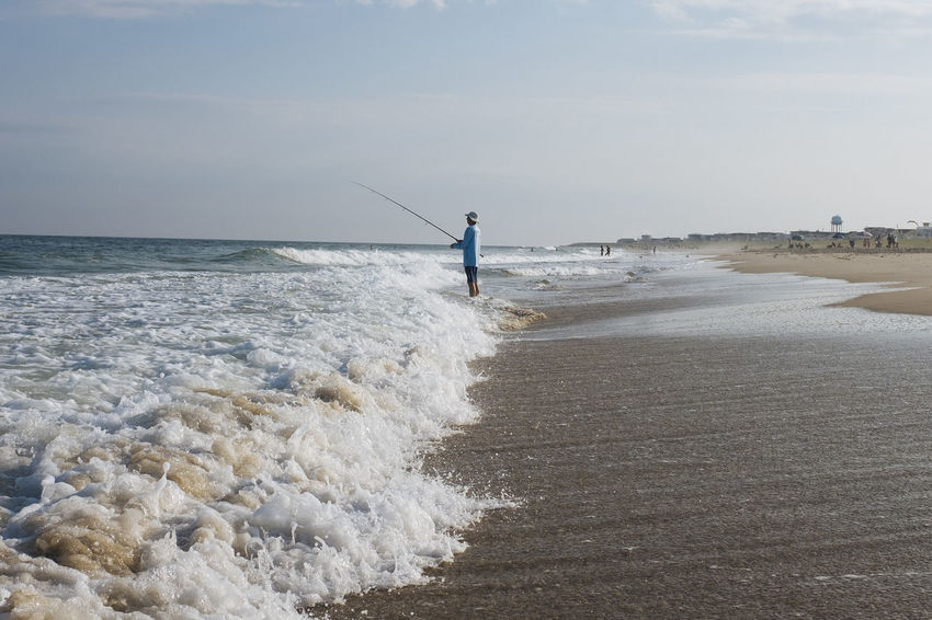 Fishing and Crashing Waves on Long Beach Island New Jersey Beach Beauty In Nature Day Fishing Pole Full Length Horizon Over Water Leisure Activity Long Beach Island Motion Nature One Person Outdoors People Real People Sand Scenics Sea Sky Standing Vacations Water Wave Weekend Activities