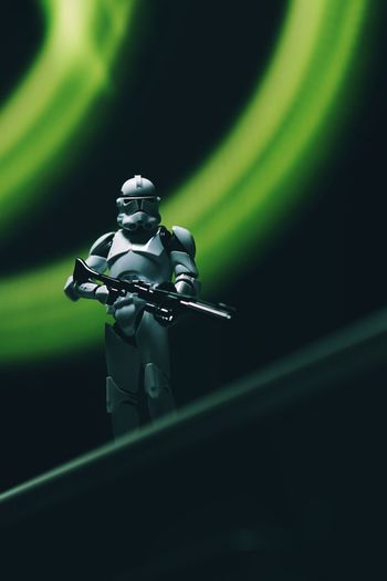 Star Wars Clonetrooper Clone Trooper Star - Space Hobby Toys Scale Model Scale Model Photography Human Representation No People Male Likeness Representation Night Figurine  Art And Craft Illuminated Close-up Green Color Black Background Indoors  Robot Studio Shot Toy Still Life Creativity Spotlight Technology Stage Light Painting