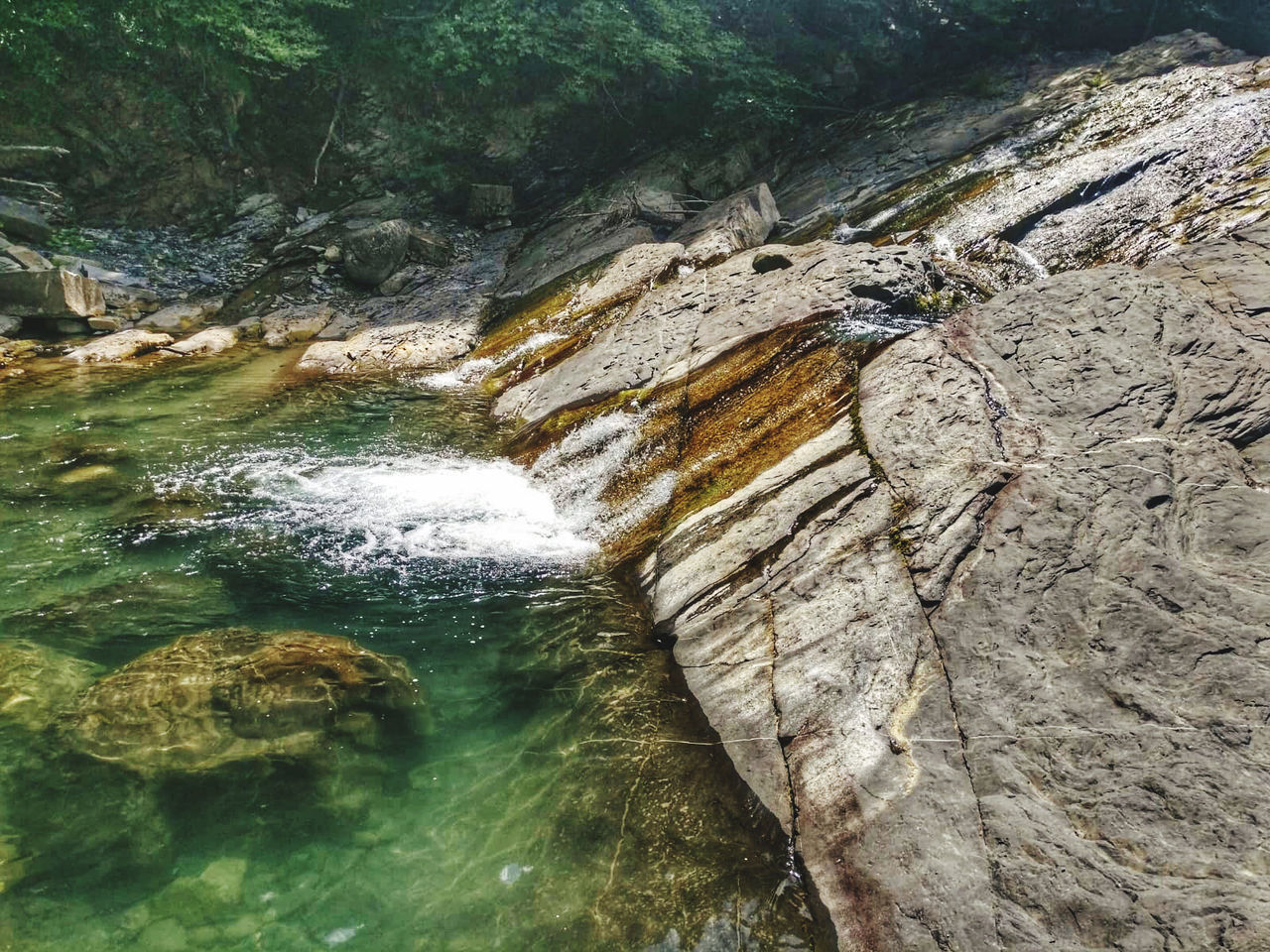 rock, rock - object, beauty in nature, solid, water, nature, scenics - nature, no people, rock formation, day, tree, motion, waterfall, tranquility, land, flowing water, non-urban scene, forest, plant, outdoors, flowing, eroded, formation