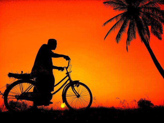 the Heros Photography INDONESIA Aceh Culture Aceh Water Sunset Tree Bicycle Silhouette Sport Orange Color Sky Shore Red Background Cycling Helmet Riding Mountain Bike Orange Background Cycling Motocross Motorcycle Motorized Vehicle Riding Bicycle Basket Crash Helmet Motorsport Motorcycle Racing Formula One Racing Off-road Vehicle Skiing Helmet Exercise Bike