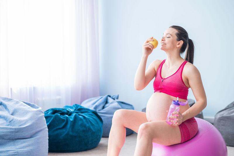 Full length of woman sitting in bottle