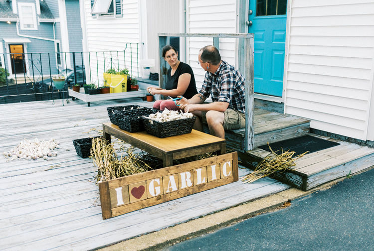 Man and woman preparing food outdoors