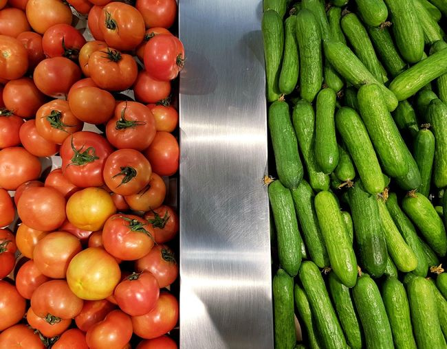 I say tomato, you say cucumber Freshness Food And Drink Fruit Food Green Color Supermarket Healthy Eating Right Left Separation Division EyeEm United Arab Emirates Dubai Photography EyeEm Gallery Multi Colored Market Variation Freshness Vegetables Cucumber Tomato EyeEm Best Shots